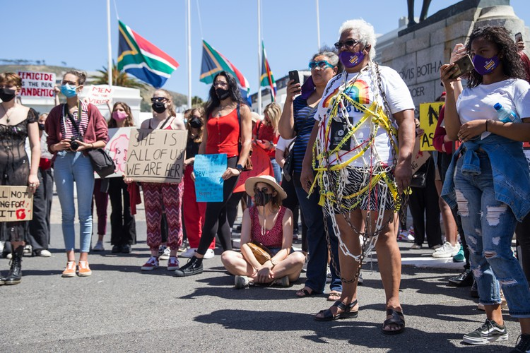 Venetia Orgill, an ambassador for SA women Fight Back, attended the protest wrapped in chains and police tape. Photo: Ashraf Hendricks