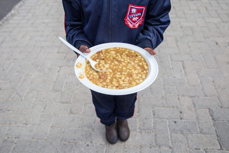 Photo of a child holding a plate of food