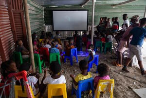 Photo of children watching movie