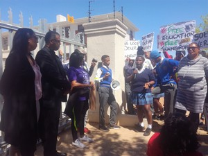 Photo of marchers at magistrates court