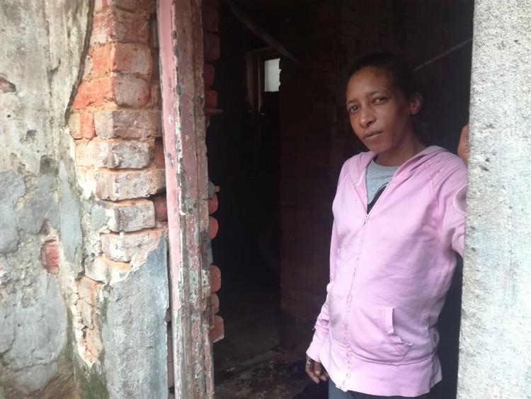 Photo of woman in broken doorway