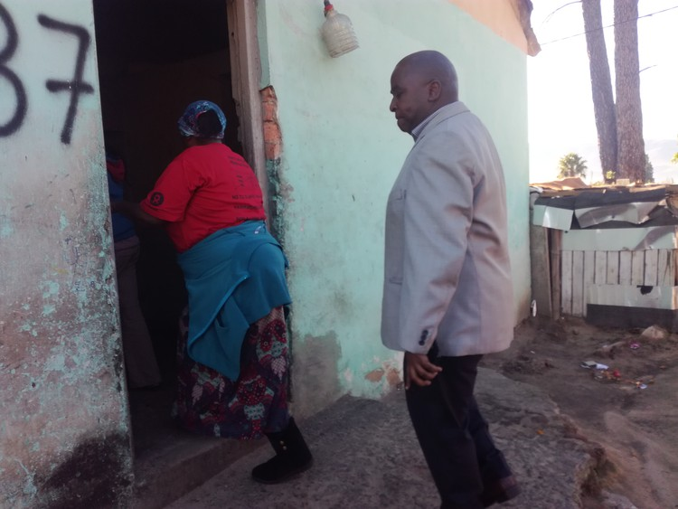 Photo of woman showing man  a house