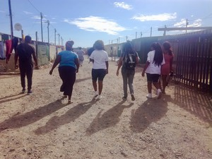 Photo of four people walking