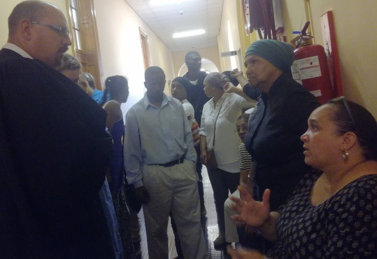Photo of residents talking to lawyer