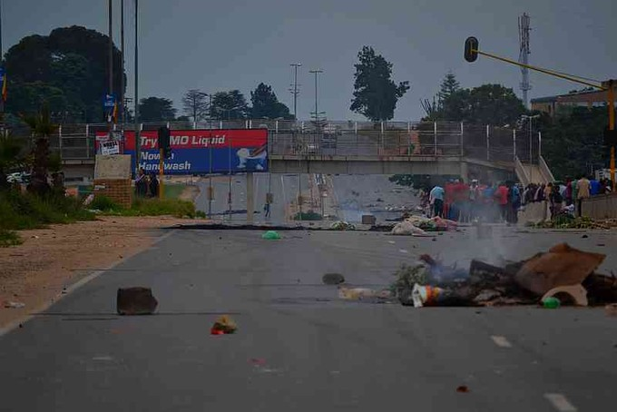 Photo of road strewn with rubbish after protest