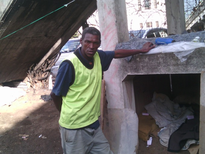 Photo of Antony Lewis in his shelter under a bridge.