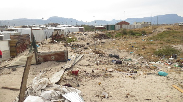 Photo of demolished shacks