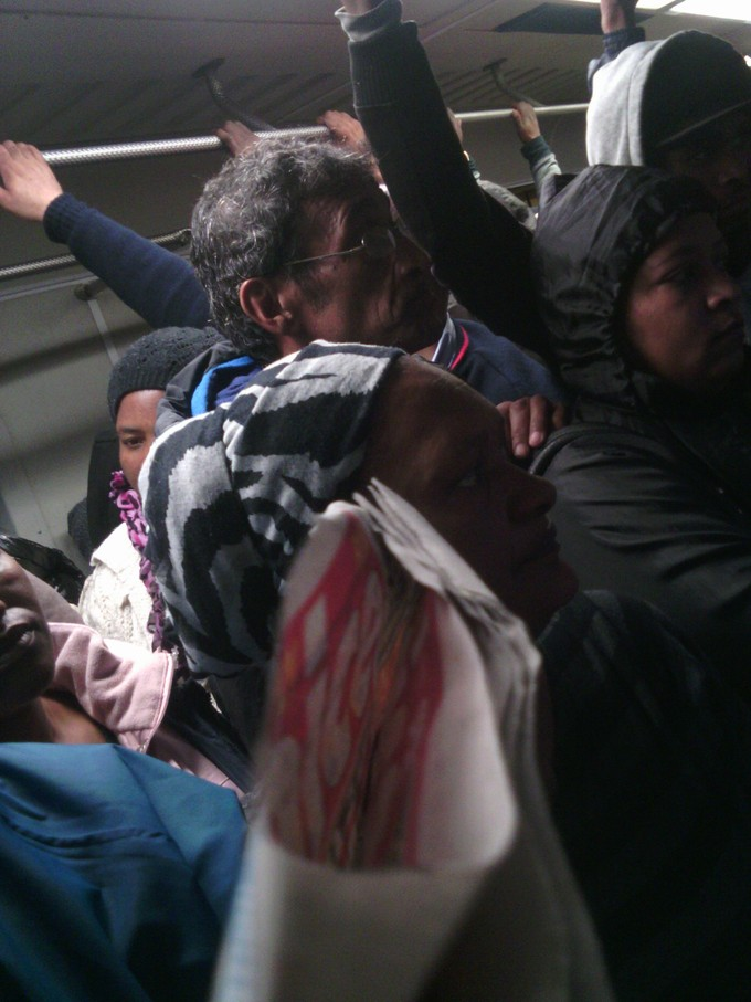 Photo of passengers in a crowded train