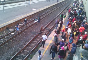 Photo of people jumping onto railway tracks