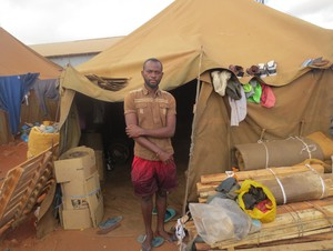 Photo of man outside tent