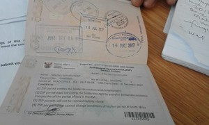 Photo of a Zimbabwean passport with a permit