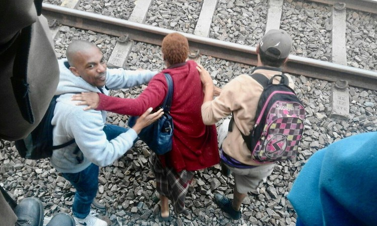 Photo of people on a railway track