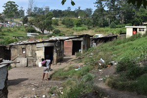 Photo of shacks on a hill