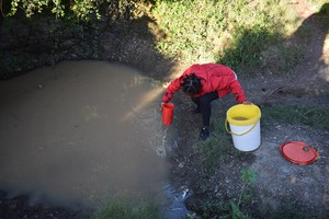 Photo of  Nwabisa collecting water