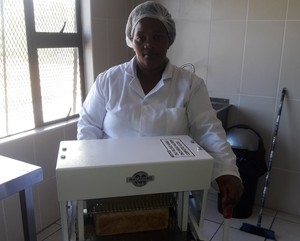 Photo of woman at bread machine