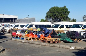Photo of fruit sellers at a taxi rank