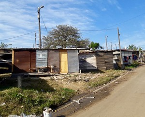 Photo of a street with shacks
