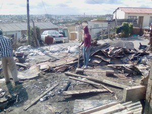 Photo of fire debris in an informal settlement