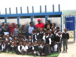 Photo of school children in front of toilet block
