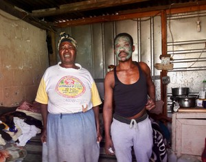 Photo of two people in a shack