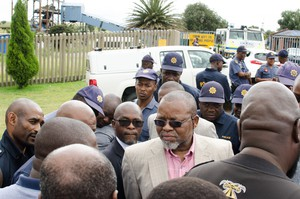 Photo of Gwede Mantashe surrounded by police