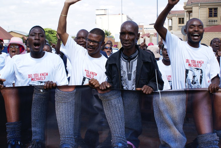Photo of protesters at Michael Komape trial