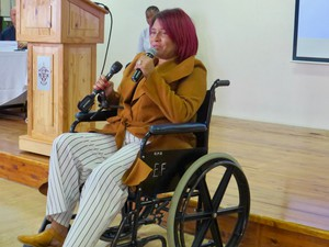 Photo of a  woman in a wheelchair