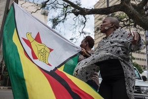 Zimbabweans celebrate call to remove Mugabe