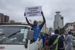 Thousands of Zimbabweansmarch for the removal of Robert Mugabe.
