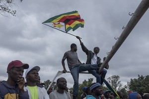 Thousands of Zimbabweans march for the removal of Robert Mugabe.