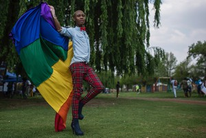 Photo of a man with the rainbow flag