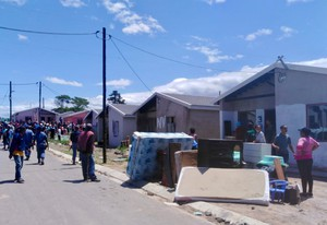 Photo of a street with evictions taking place