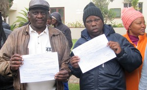 Photo of two men with documents