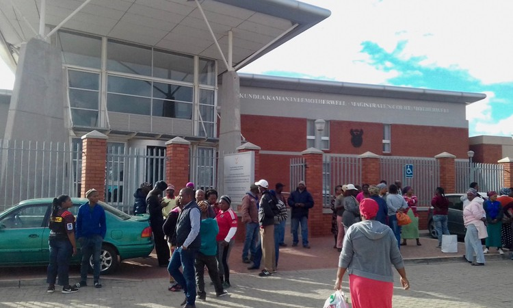 Photo of people outside a court building