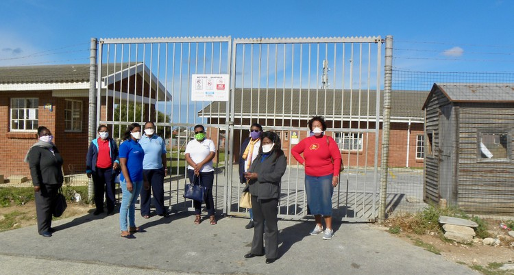 Nursing staff at Motherwell NU2 clinic stand outside the main gate. The clinic was closed on Tuesday after staff members tested positive for Covid-19. Photo: Joseph Chirume