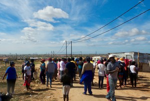 Photo of people in an informal settlement