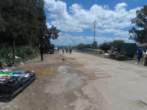 Photo of pothole-ridden road in Addo\'s town centre