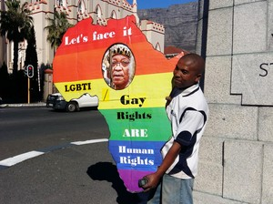 Photo of man protesting for LGBT rights