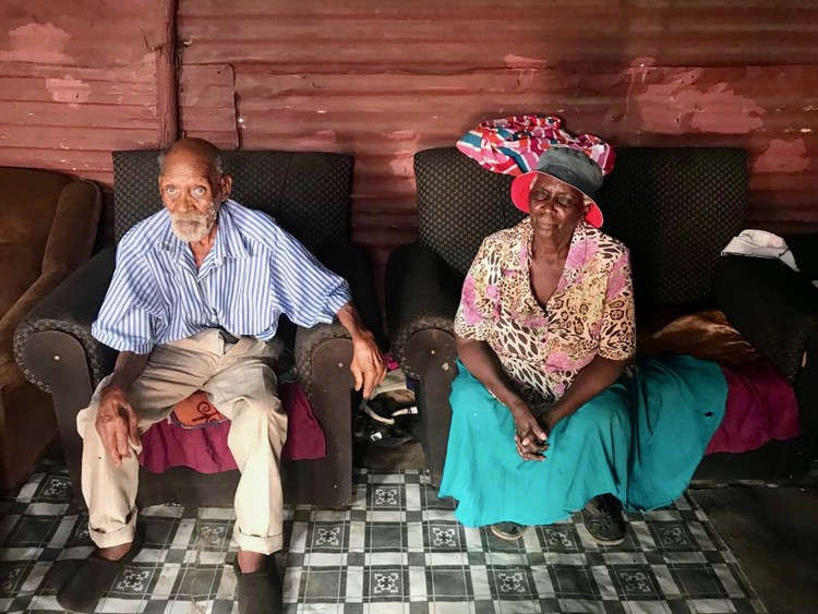 Photo of an elderly couple sitting