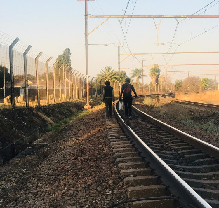 Photo of two men on a railway line