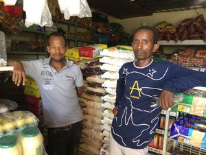 Photo of two men in small shop