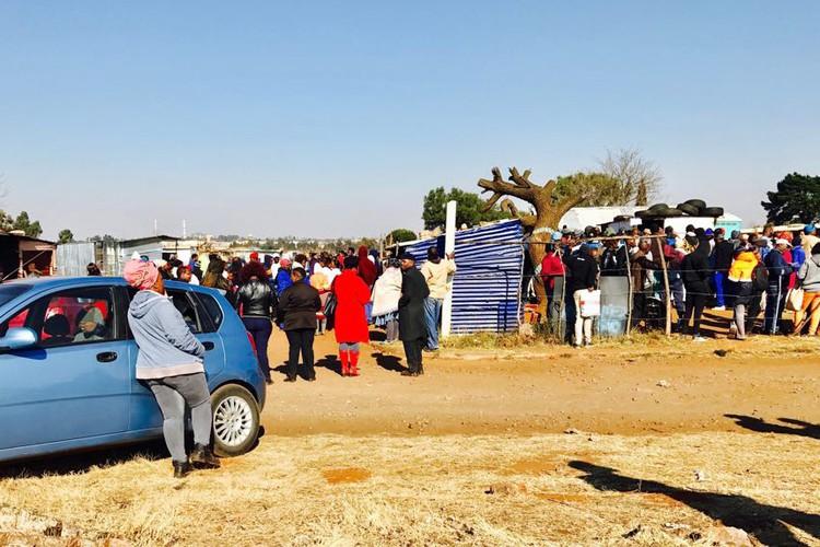 Photo of people in queue