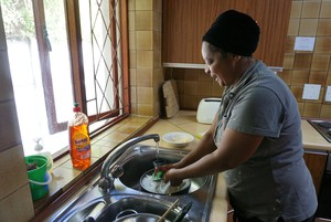 Zanele Tasana spends her working day cleaning at a lodge in Observatory. Photo: Kristine Liao