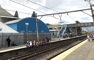 Photo of people waiting on platform