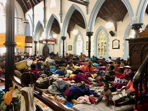 Photo of refugees in church