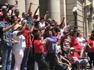 Photo of people on steps of court
