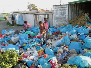 Photo of children playing in rubbish tip