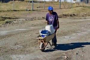 Photo of a man with a wheelbarrow
