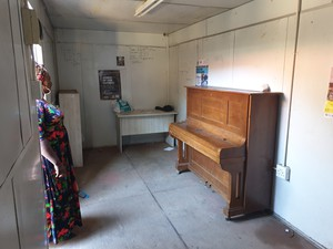Photo of piano in container
