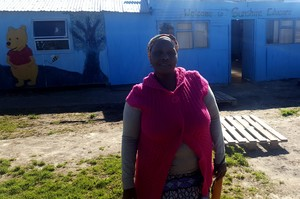 Photo of woman in front of creche